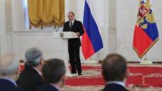 Президент РФ Владимир Путин во время ежегодного торжественного приёма в Кремле по случаю празднования Дня Героев Отечества. 9 декабря 2016