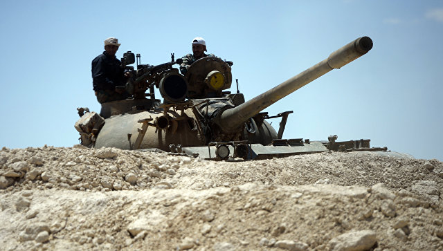 Танк сирийской армии при подъезде к Пальмире. Архивное фото