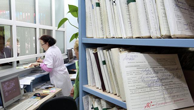 В регистратуре районной поликлиники. Архивное фото