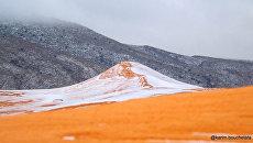 Снег в пустыне Сахара. Архивное фото