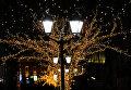 Новогодняя иллюминация в Камергерском переулке в Москве