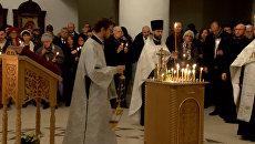 Зажжённые свечи и молитвы: В Париже прошла панихида по жертвам крушения Ту-154