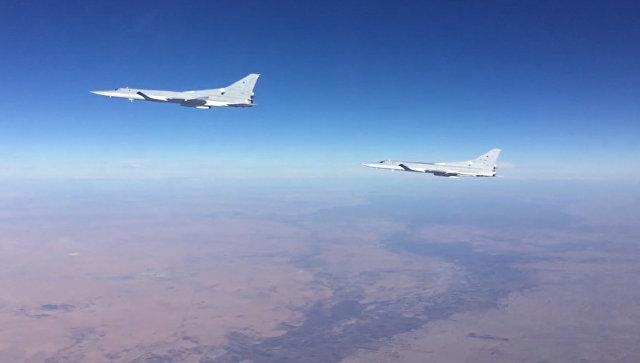 Кадры авиаударов российских Ту-22м3 по позициям боевиков ИГ в Сирии