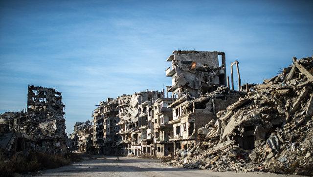 Разрушенные здания в районе Старого города в Хомсе