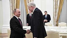 Президент РФ Владимир Путин и премьер-министр Баварии Хорст Зеехофер. Архивное фото