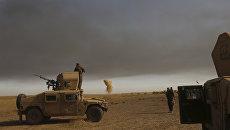 Дым на месте авиаударов ВВС США в окрестностях Мосула. Архивное фото