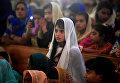 Девочка на пасхальной мессе в Исламабаде, Пакистан