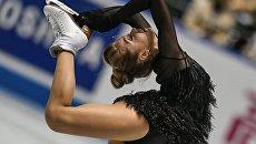 Елена Радионова (Россия) выступает в короткой программе женского одиночного катания на командном чемпионате мира по фигурному катанию в Токио. Архивное фото