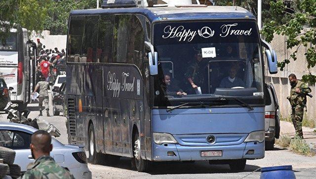 Вывоз боевиков и членов их семей из пригорода Дамаска. Архивное фото