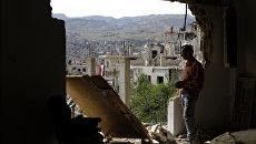 Последствия авиаударов в сирийском городе Забадани