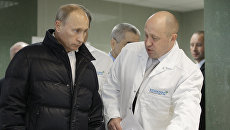 Владимир Путин и Евгений Пригожин. Архивное фото