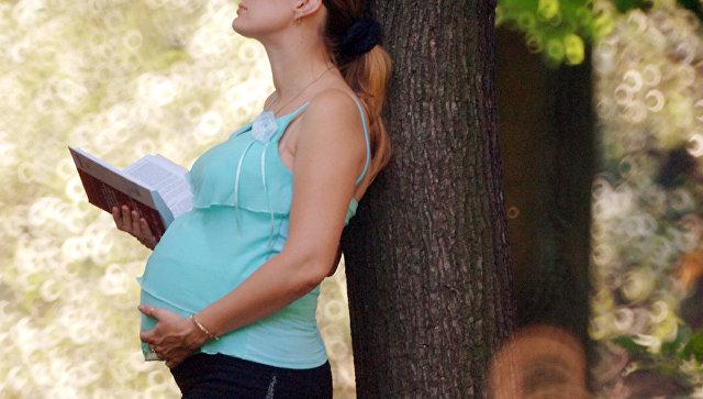 Беременная девушка. Архивное фото