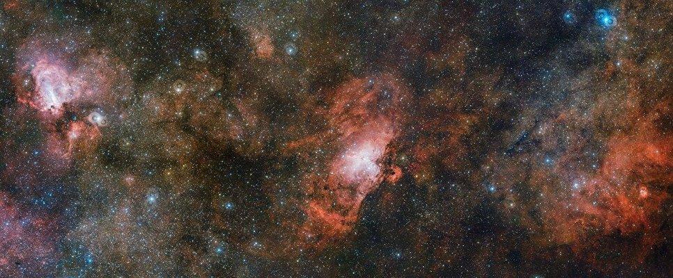 Облако газа Sharpless 2-54, туманности Орла и Омега снятые телескопом VST