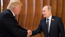 Президент России Владимир Путин и президент США Дональд Трамп на саммите G20 в Гамбурге. 7 июля 2017
