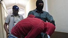 Подозреваемый в подготовке теракта в Москве Муродбек Кодиров перед заседанием в Мещанском суде Москвы. 1 сентября 2017