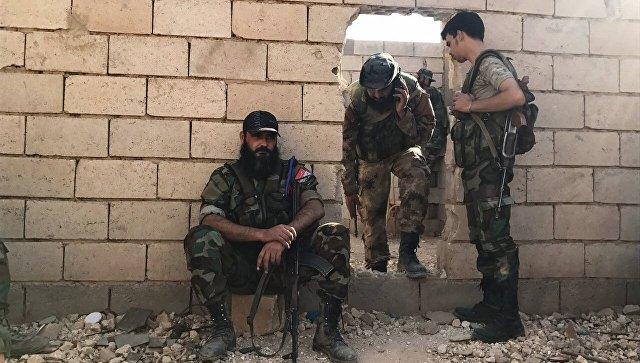 Бойцы сирийской армии в городе Дейр-эз-Зор