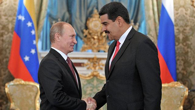 Президент России Владимир Путин и президент Боливарианской Республики Венесуэла Николас Мадуро во время встречи в Большом Кремлевском дворце