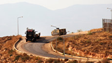 Турецкая бронетехника около сирийской северо-западной провинции Идлиб. Архивное фото