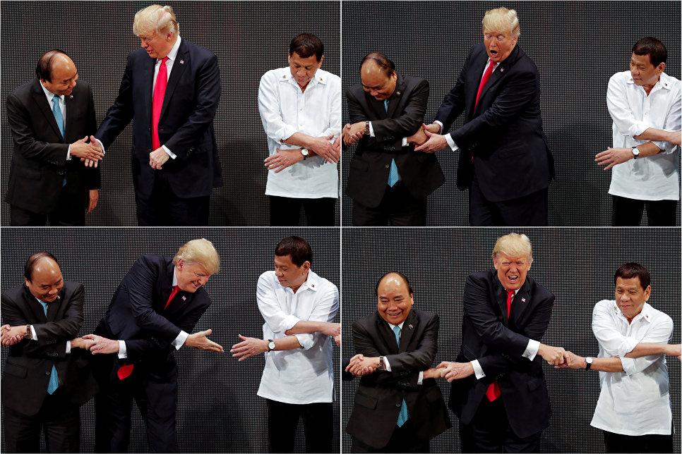 Премьер-министр Вьетнама Нгуен Суан Фук, президент США Дональд Трамп и президент Филиппин Родриго Дутерте во время традиционного рукопожатия АСЕАН