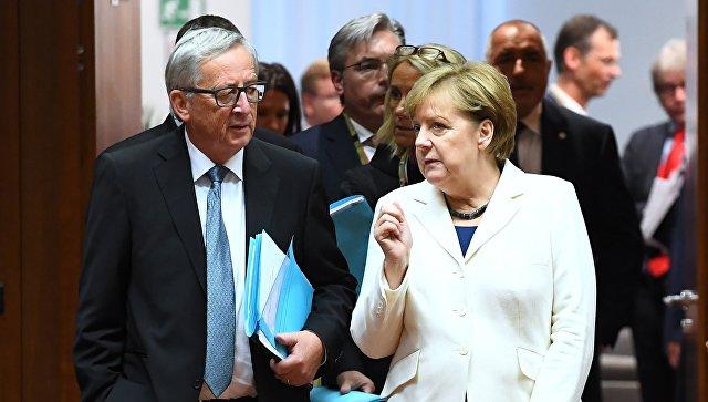 Председатель Европейской комиссии Жан-Клод Юнкер и канцлер Германии Ангела Меркель. Архивное фото