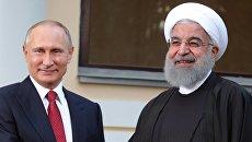 Президент РФ Владимир Путин и президент Ирана Хасан Рухани. Архивное фото
