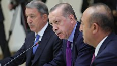Президент Турции Реджеп Тайип Эрдоган во время встречи с президентом РФ Владимиром Путиным и президентом Ирана Хасаном Роухани. 22 ноября 2017