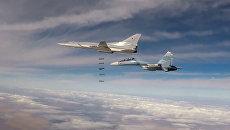 Групповой удар бомбардировщиков Ту-22М3 по позициям ИГ* в Сирии. Архивное фото