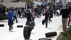 Участники акции протеста в Палестине против решения о признании Иерусалима столицей Израиля. 7 декабря 2017