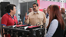 Президент Венесуэлы Николас Мадуро на Международной научно-технической ярмарке в Каракасе. Архивное фото