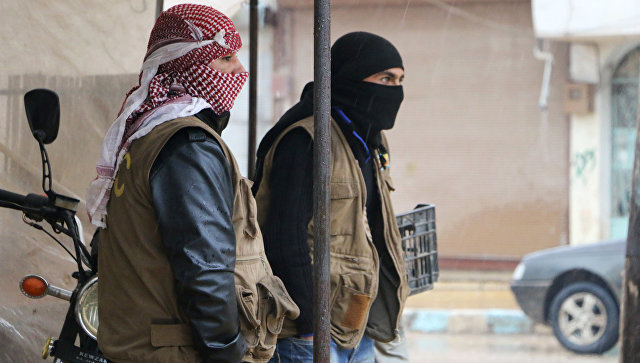Сирийские бойцы из Отрядов народной самообороны (YPG) в городе Африн