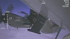 Опубликованные ВМС США кадры перехвата разведчика EP-3 российским Су-27