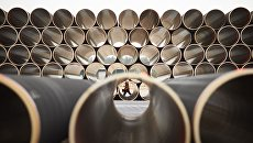 Трубы для газопровода Северный поток ‑ 2 на заводе по обетонированию в Котке, Финляндия