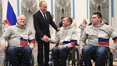 Президент РФ Владимир Путин во время встречи с российскими спортсменами – победителями и призёрами XII Паралимпийских зимних игр в Пхёнчхане. 20 марта 2018