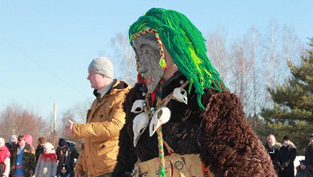 Участник празднования языческой Масленицы (Комоедицы) в деревне Турейка Наро-Фоминского района Московской области