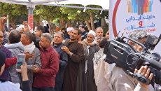 Люди перед избирательным участком в Каире во время президентских выборов в Египте. 26 марта 2018