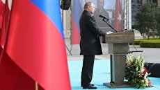 Президент РФ Владимир Путин выступает на церемонии запуска строительства первого энергоблока АЭС Аккую. 3 апреля 2018