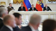 Президент РФ Владимир Путин и председатель правительства РФ Дмитрий Медведев на заседании Государственного совета. 5 апреля 2018