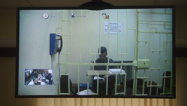 Совладелец и председатель совета директоров группы Сумма Зиявудин Магомедов во время видеоконференцсвязи в зале Московского городского суда. 16 апреля 2018