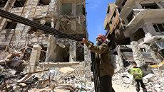 Разрушенные здания в Думе. Архивное фото