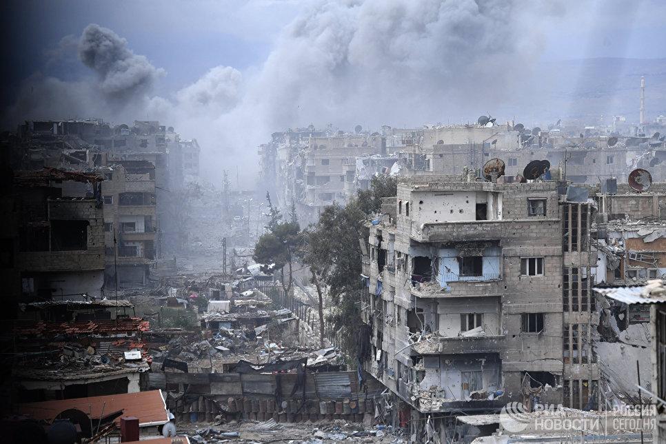 Разрушенные строения в районе бывшего лагеря палестинских беженцев Ярмук в южном пригороде Дамаска