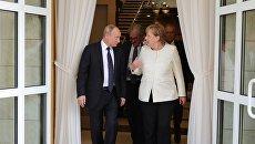 Президент РФ Владимир Путин и федеральный канцлер ФРГ Ангела Меркель после переговоров в Сочи. 18 мая 2018