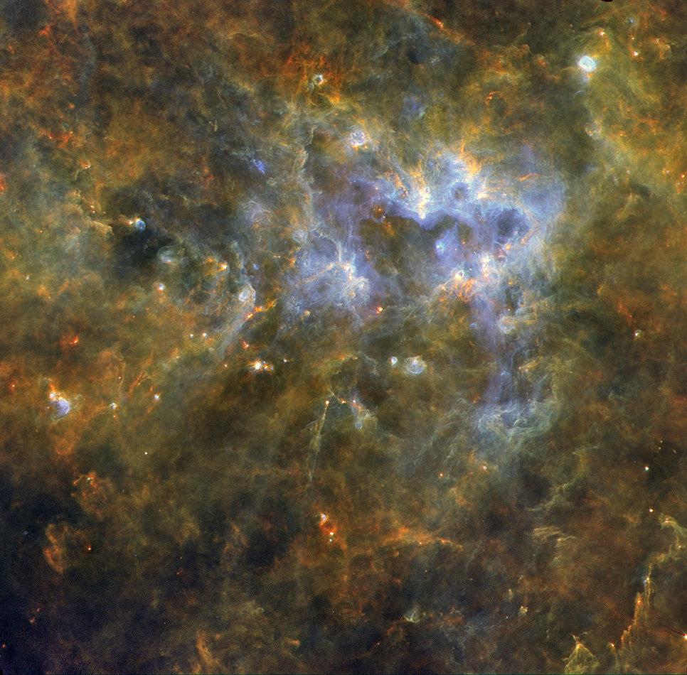 Звездообразующий комплекс G305 снятый телескопом Гершель