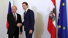 Президент РФ Владимир Путин и Федеральный канцлер Австрии Себастьян Курц во время встречи в Вене. 5 июня 2018