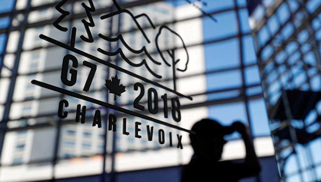 Логотип саммита G7 на здании пресс-центра в Квебеке, Канада. 7 июня 2018