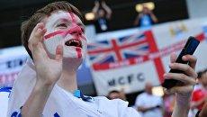 Болельщик сборной Англии перед матчем группового этапа чемпионата мира по футболу между сборными Англии и Бельгии