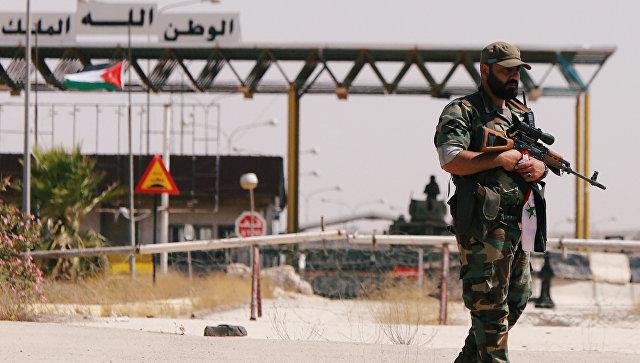 Солдат сирийской армии на пограничном переходе Насиб, Сирия. 7 июля 2018