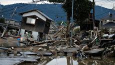 Разрушенные дома в затопленном районе в в Курасики, Япония. 8 июля 2018