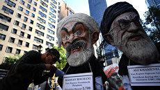 Демонстранты протестуют против президента Ирана Хасана Рухани. Архивное фото