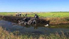 На месте крушения вертолета Ми-2 в Краснодарском крае, в результате которого погибли два человека. 2 августа 2018