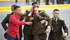 Раненный офицер после покушения на президента Венесуэлы Николаса Мадуро. 4 августа 2018